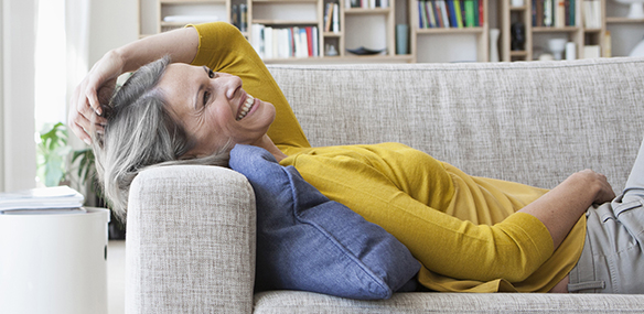Older woman lying on couch