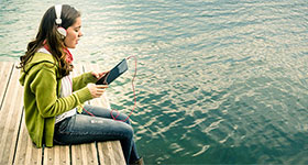 Girl Wearing Headphones On Dock