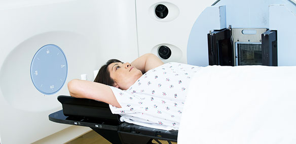 Woman receiving radiation therapy