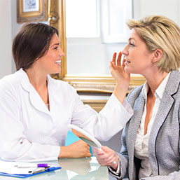 Cosmetic surgeon and patient consultation