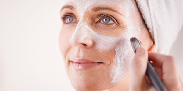 Mature          woman with facial mask