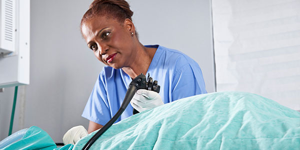 Female healthcare worker performing endoscopy