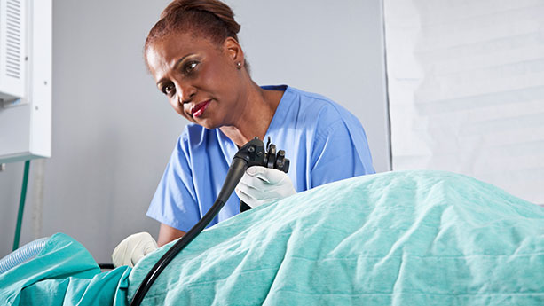 Healthcare worker performing endoscopy
