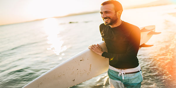 Caucasian Male Holding Surfboard
