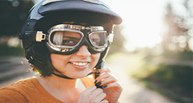 Woman Wearing Bike Helmet And Goggles
