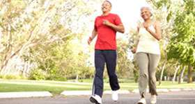 Middle-aged African-American couple jogging