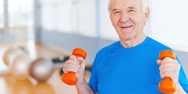 Elderly man exercising with free weights