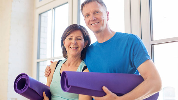 Couple with yoga mats