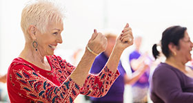 Senior woman taking dance class
