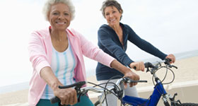 Two mature women on bikes