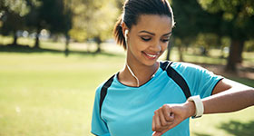 Woman checking fitness device
