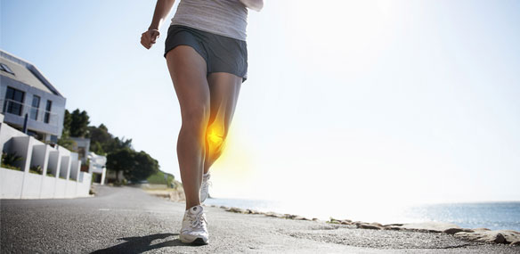 Woman running knee joint emphasis