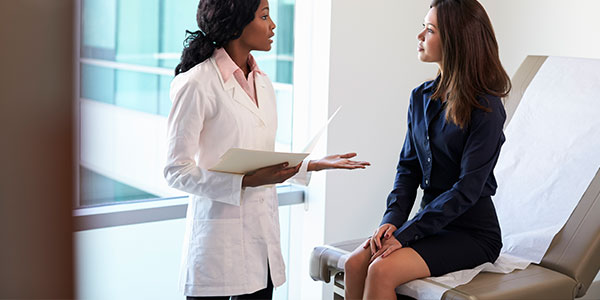 Female physician speaking to female patient