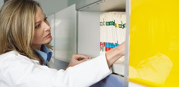 caucasian female working in medical records