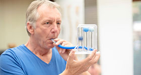 Caucasian man doing breathing test