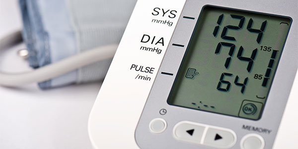 Blood pressure cuff reading 124 over 74