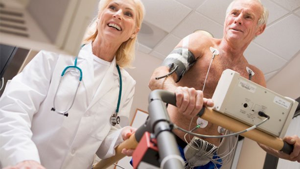Elderly white man having heart treadmill stress test