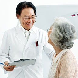 Asian doctor talking with female Asian patient