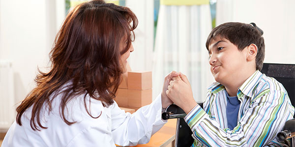 Disabled boy and doctor handshake