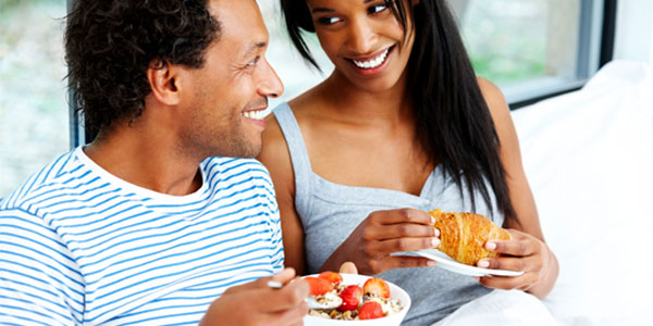 African-American couple eating breakfast