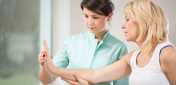 white-woman-stretching-wrist-rehabilitation