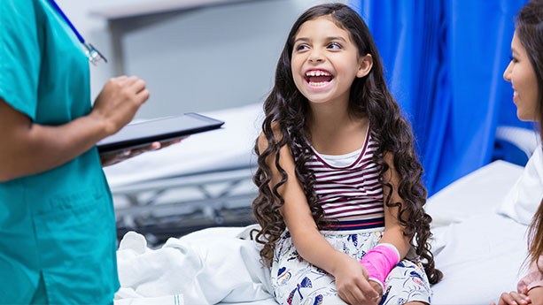 Little girl with arm cast in Emergency Room