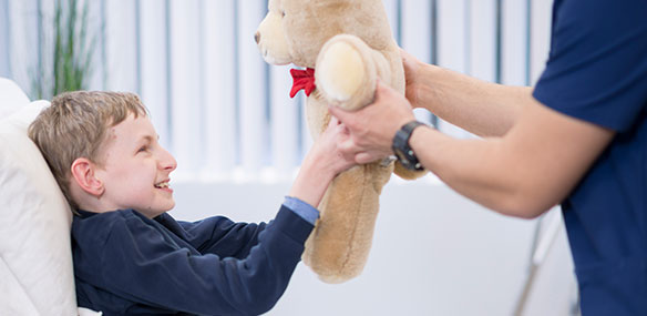 pediatric patient receiving teddy bear