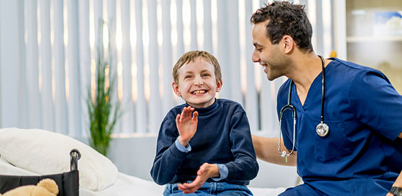 Special needs boy with doctor