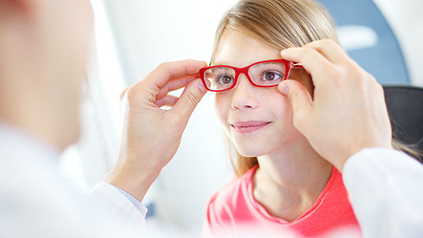 young caucasian girl being fitted for eye glasses