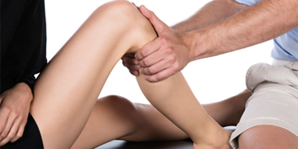 Close up of knee massage therapy