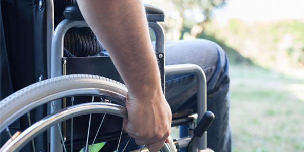 Close up of man using wheelchair