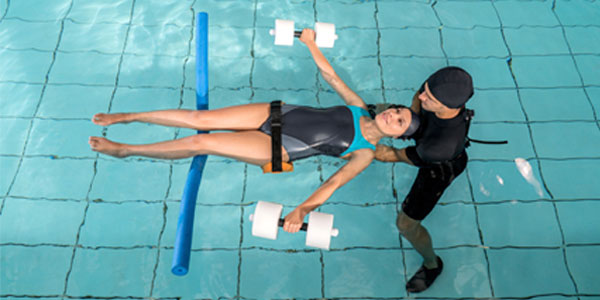 Female undergoing aquatic therapy