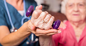 Senior woman hand therapy