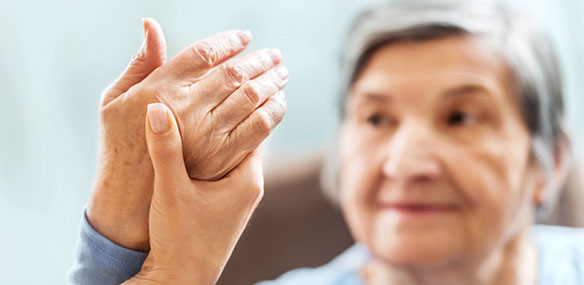 Senior woman having hand therapy