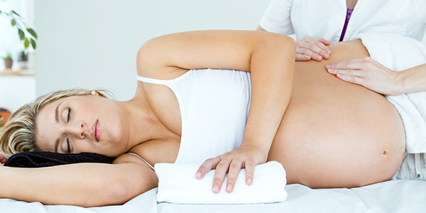 Pregnant woman receiving massage