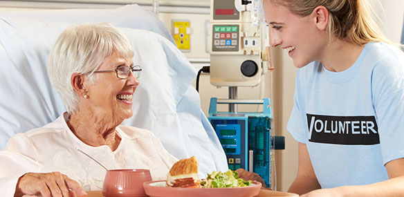hospital volunteer serving food