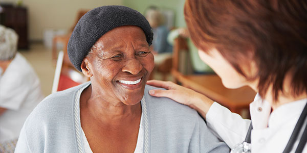 Nurse with African American senior patient