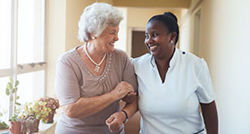 Smiling caregiver and senior woman