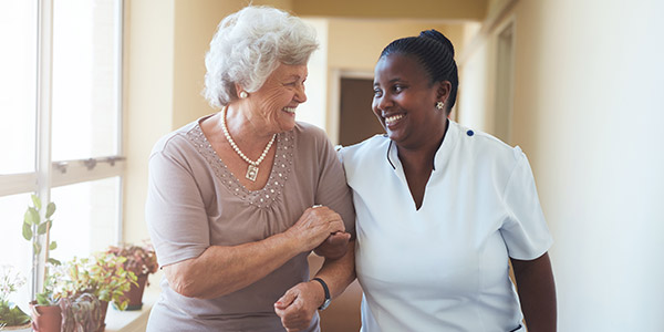 Smiling caregiver and woman