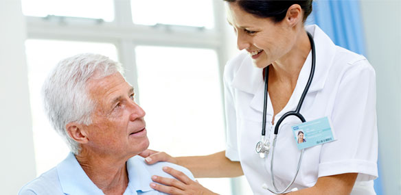 Elderly male patient with nurse