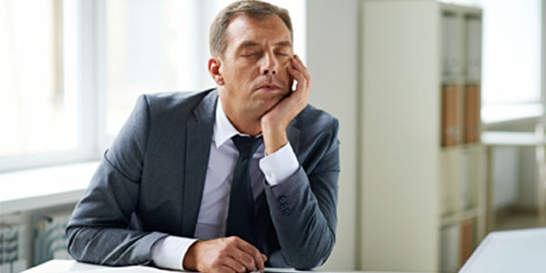 Man asleep at office desk