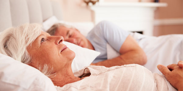 Middle-aged woman sleepless in bed