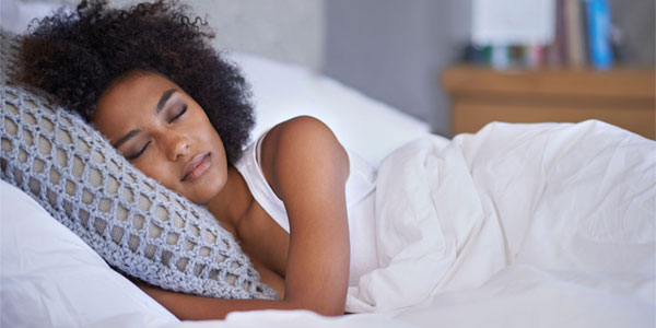 African-American woman peacefully asleep in bed