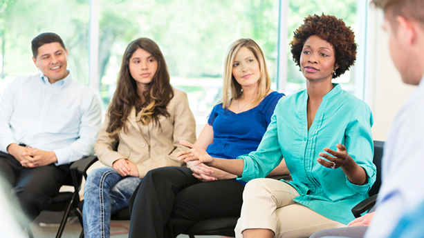 African American woman participates group therapy