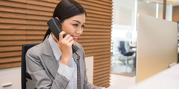 Female                receptionist on phone