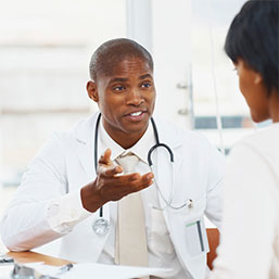 African american male doctor with african american female patient