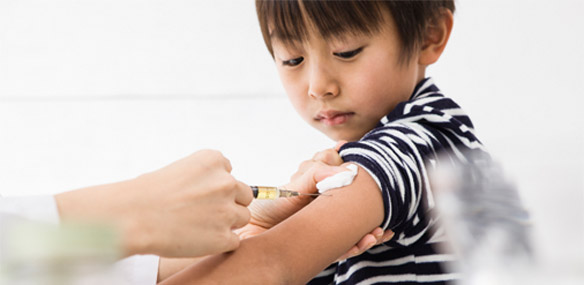 Asian boy getting immunization