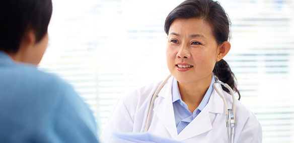 Asian doctor and patient