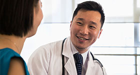 Asian doctor with patient