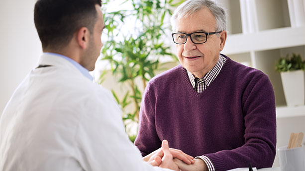 Older man talking with doctor